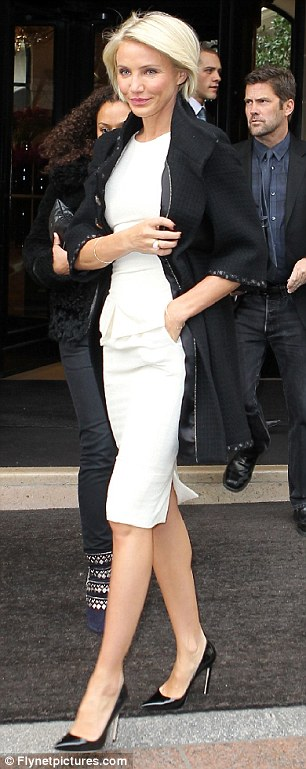 Stunning: Cameron looked chic and sophisticated as she made the Paris Fashion Week rounds yesterday