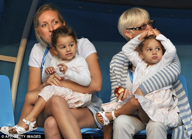 Go Dad:  Roger Federer's twin daughters Myla Rose and Charlene Riva watch him in action
