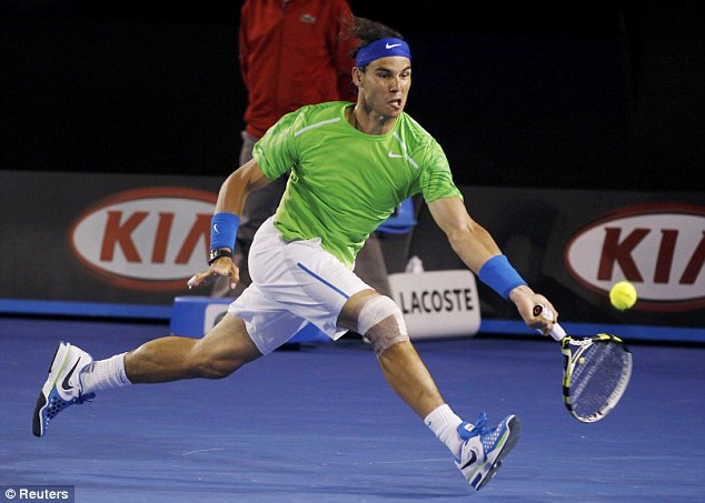 Never give up: Rafael Nadal chases down another one against Roger Federer
