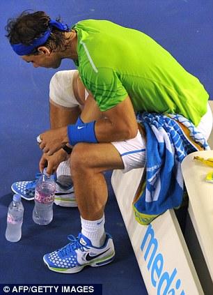 Thirsty work: Rafael Nadal takes some water