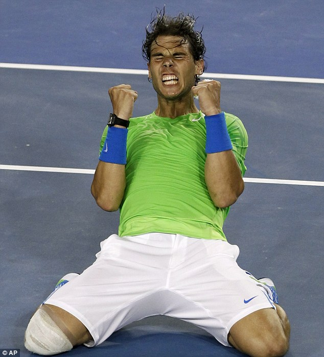 He's done it: Rafael Nadal lets out a roar as he celebrates beating Roger Federer