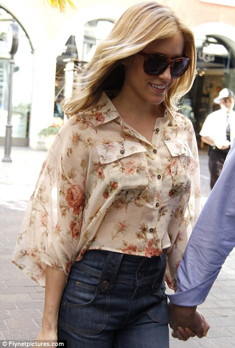 Flower power: Kristin's blouse was the perfect item to match the flared jeans with