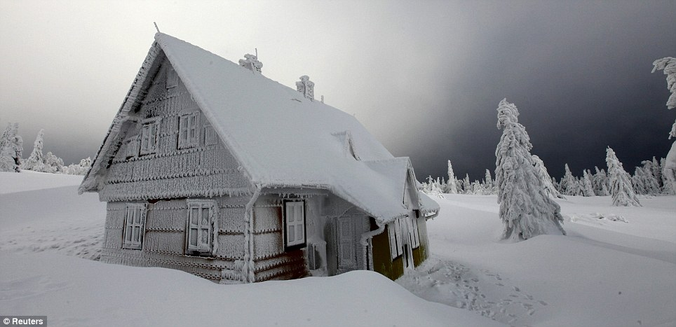 Perfect setting? This snowbound home hidden in the forests in the Czech Republic could act as the perfect gingerbread house for a winter version of Hansel and Gretel
