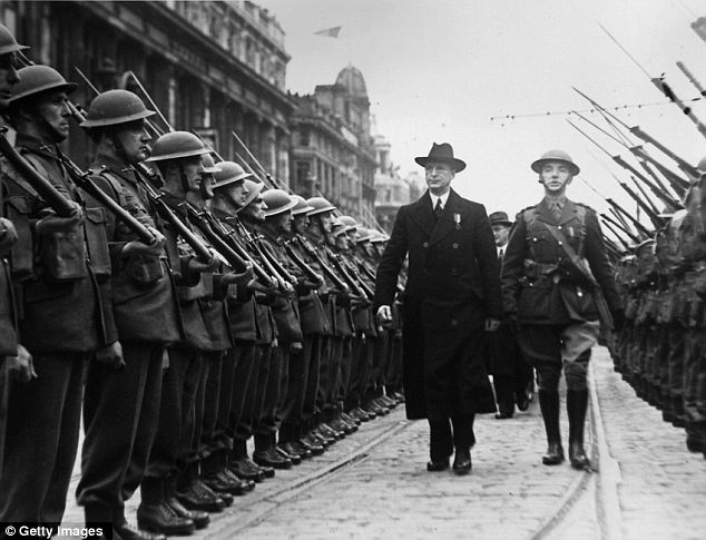 Persecuted: A group of Irish Defence Force troops are inspected by Taioseach Eamon de Valera. As many as 5,000 troops lived in fear after the War because they deserted to help the British despite Ireland's neutrality