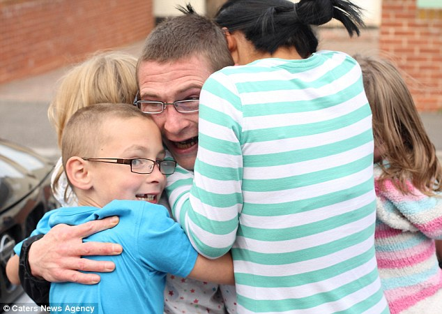 Family man? Bishop with his children after winning an appeal in May last year