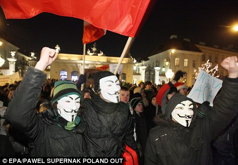 Demo: Angry masked protesters made their point in Poland after their country became the latest to sign up to the anti-counterfeit agreement