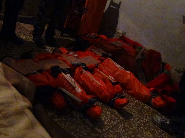 Massacre: The bodies of families that were killed during the bombing in Homs