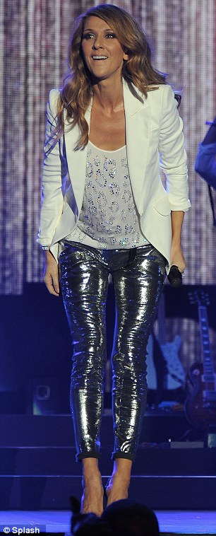 Glitter girl: Celine Dion wore disco-ball like silver leggings while performing at the Jamaica Jazz and Blues festival yesterday
