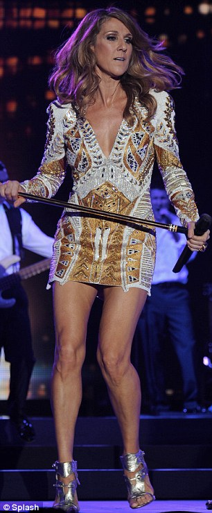 Short and sweet: The singer changed into this thigh-high mini dress