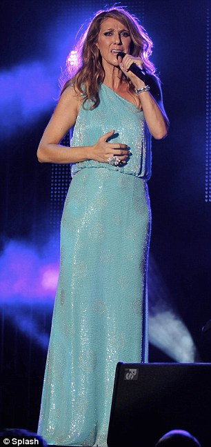 Blue belle: Ms. Dion changed into a floor-length, one-shouldered aqua-coloured frock