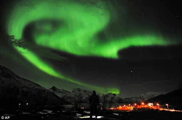 The aurora borealis, or Northern Lights, are seen near the city of Tromsoe, northern Norway, last Tuesday