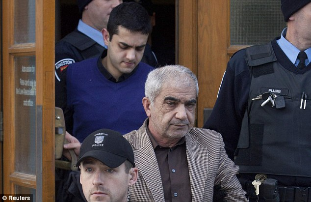Guilty: Mohammad Shafia, right and his son, Hamed Mohammed Shafia, left, being brought out of the Frontenac County courthouse in Kingston, Ontario, Canada