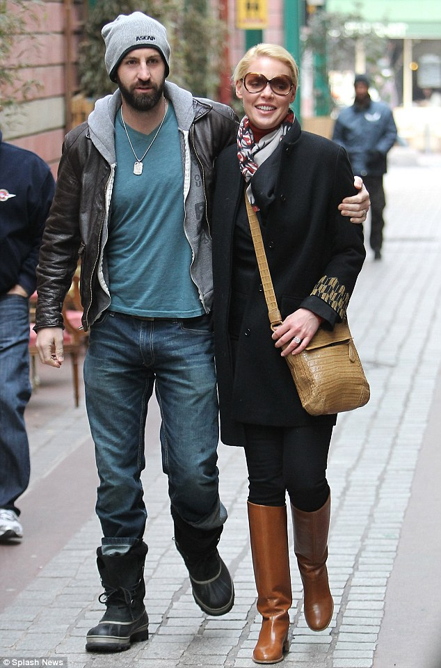 Romantic stroll: Josh and Katherine wrapped their arms around each other as they strolled around the Parisian streets