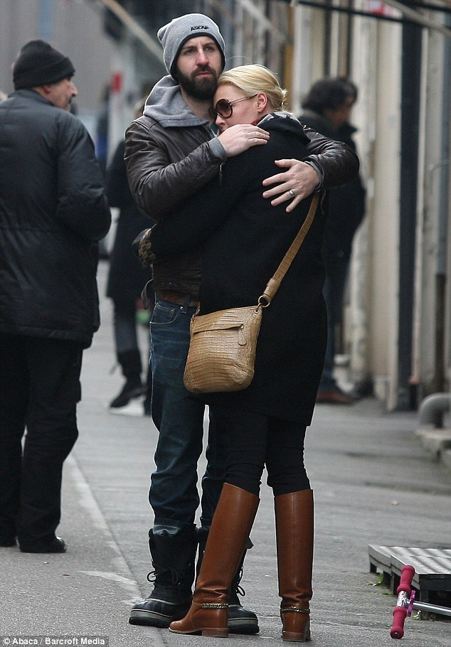 Affection: Blending into the bustling crowd, the couple also enjoyed some cuddles, keeping each other warm from the wintery conditions