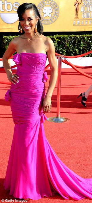 Red carpet style: Maria Menounos opted for a tight satin gown, Shaun Robinson donned a strapless hot fuscia dress