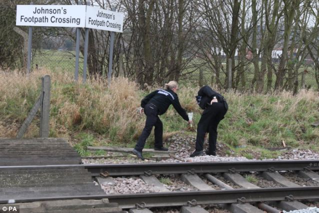 Farewells: Police officers pay their respects at the scene where the schoolgirl died