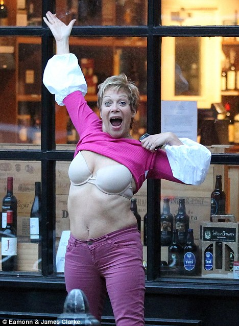 Put them away, love! Denise flashed her chest outside a wine specialist called Corks Out! during her husband's 60th birthday celebrations over the weekend