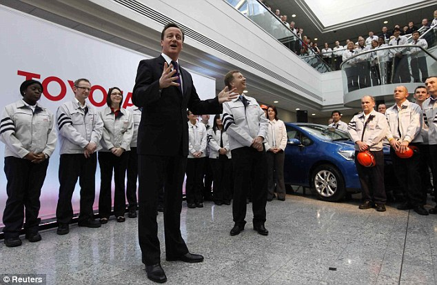 David Cameron speaks to workers at the Toyota factory in Burnaston, central England last year. In 2009 Mr Sarkozy attacked a VAT rise in Britain, saying it had 'absolutely failed' to stimulate the economy