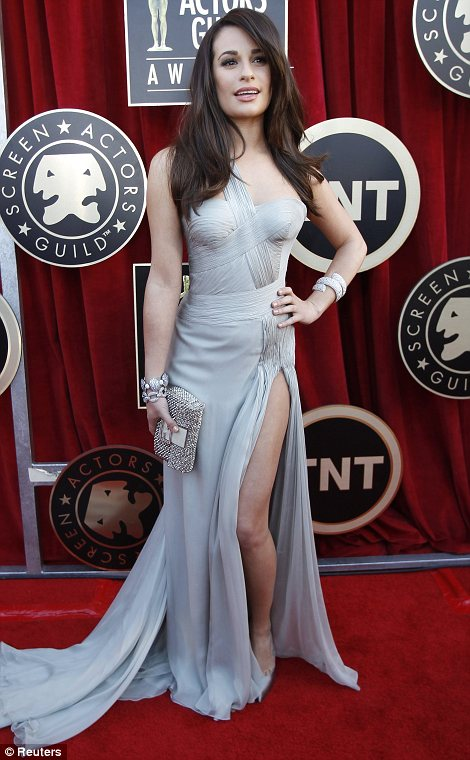 Glee-ful: Lea Michele looked stunning in a pale grey dress with a thigh-high split and a glamorous long train