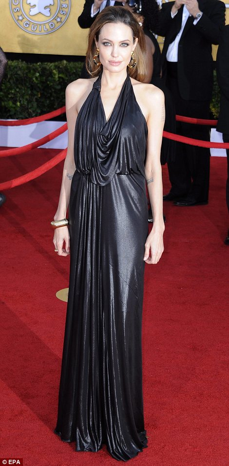Simple and sophisticated: Angelina Jolie opted for a draped Grecian-inspired gown in shining lamé