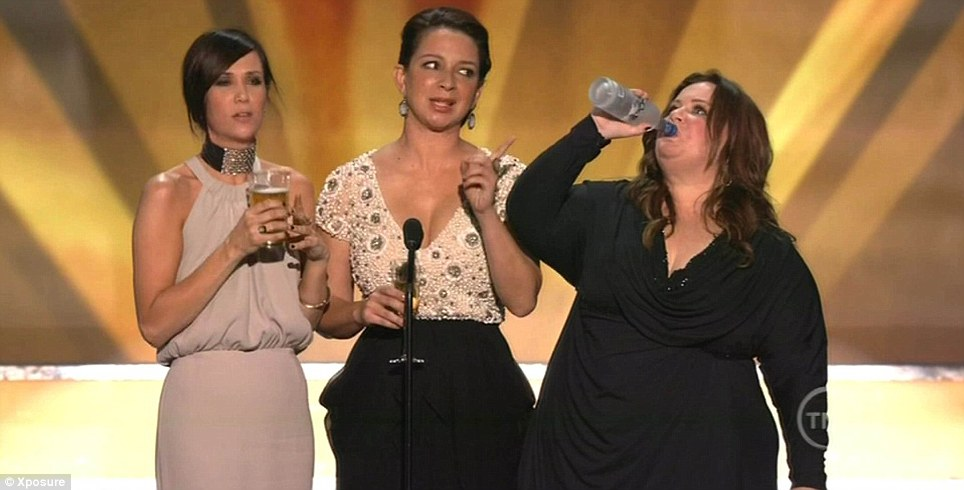 Funny women: Bridesmaids stars Kristen Wiig, Maya Rudolph and Melissa McCarthy got the glitzy crowd playing drinking games