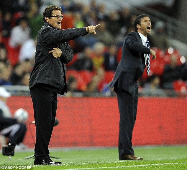 Wales manager: Gary Speed, right, on the touchline alongside England boss Fabio Capello in September as the Welsh lost 1-0 to England in a European Championship qualifying match
