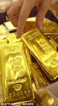 Gold drop: Despite falls in price at the end of last year, it still finished with 10.2% gains in 2011