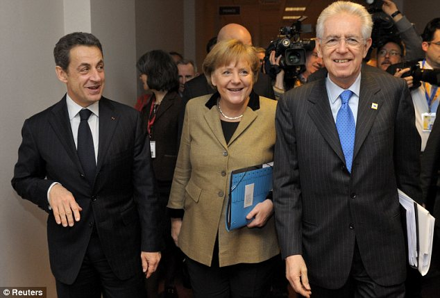 Three Musketeers: France's President Nicolas Sarkozy (left), Germany's Chancellor Angela Merkel (centre) and Italy's Prime Minister Mario Monti (right) spoke together before the summit