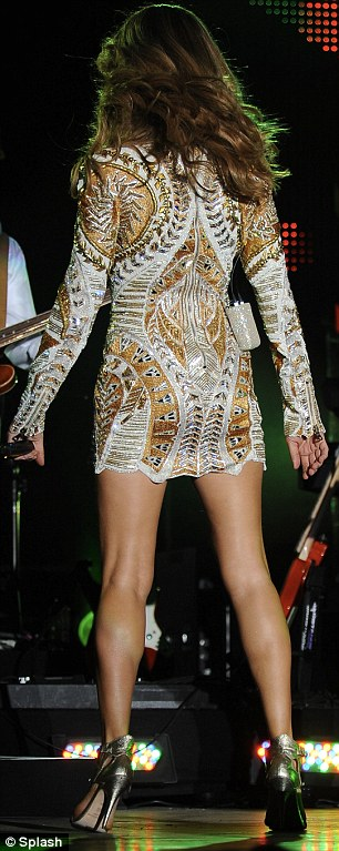 Celine Dion accidentally flashes the crowd while wearing a skimpy Balmain dress at the Jamaica Jazz