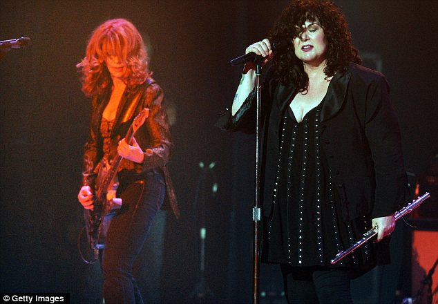 Stolen song? Sarah Palin used the Heart hit Barracuda as she campaigned in 2008, prompting guitarist Nancy Wilson, left, to say that she felt 'completely f***ed over'