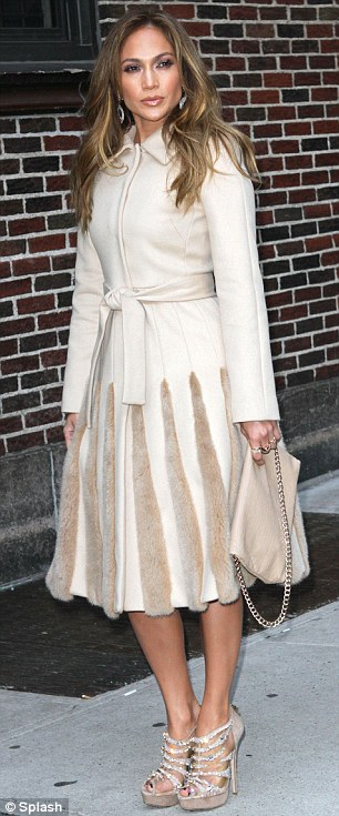 Beautiful in beige: Lopez wrapped up warm in a beige coat and matching heels as she arrived at the Ed Sullivan Theatre