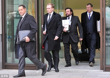 Defence: George Carter-Stephenson QC (second right) leaves court