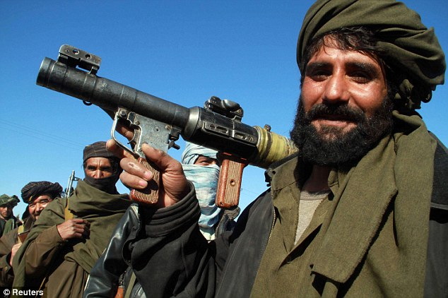 Poised: A Taliban militant holds a grenade launcher in Herat. A secret U.S. report claims the insurgent movement is poised to regain control of Afghanistan when NATO troops withdraw