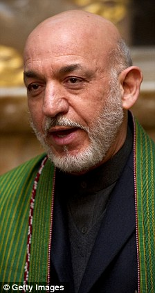 'Strong and stable': Success in Afghanistan depends on political cooperation with the government of Hamid Karzai (right)