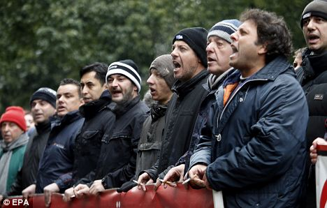 Striking steel workers shout slogans outside the Labour Ministry in Athens opposing proposals to cut their wages and rights