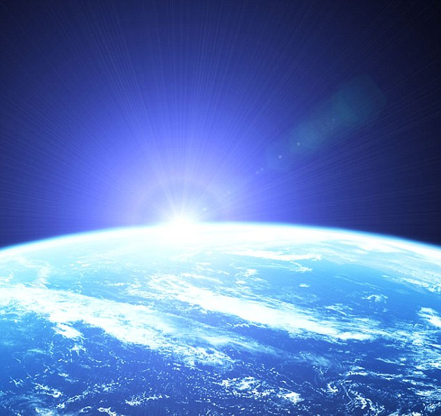 Earth as seen from space: The researchers say that the rocky world orbits its star, 22 light years from Earth, at just the right distance for liquid water on the surface - and possibly life