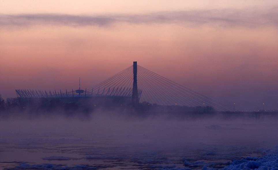 Mist rises from the partially frozen Vistula River in front of the national stadium in the centre of Warsaw, Poland