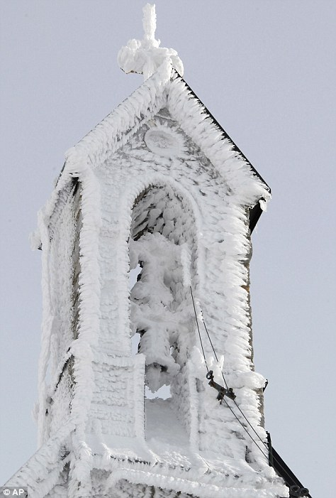 Snow clings to the tower of the Wendelstein church, Germany's highest church, set 1838 meters high on Wendelstein mountain near Bayrischzell, southern Germany