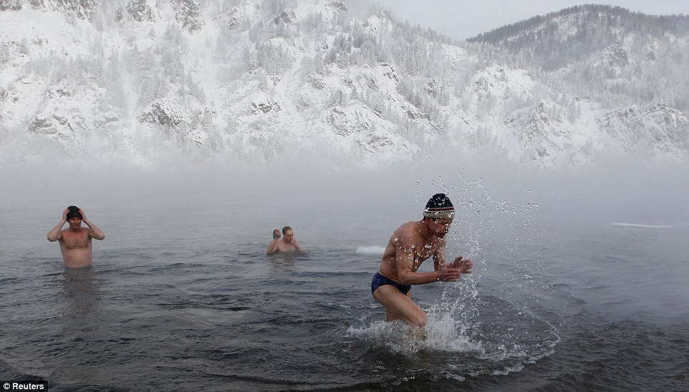 Quick, fetch me a towel! The brave swimmers shiver in the river as the air temperature around them falls to -25c. The icy temperatures have been repeated across eastern Europe