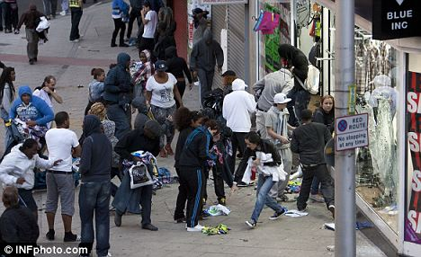 Anarchy: Peckham looters smash windows and take clothing