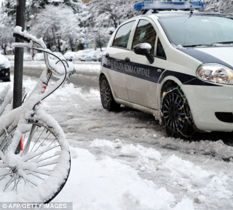 A police car drives with snowchains in Rome