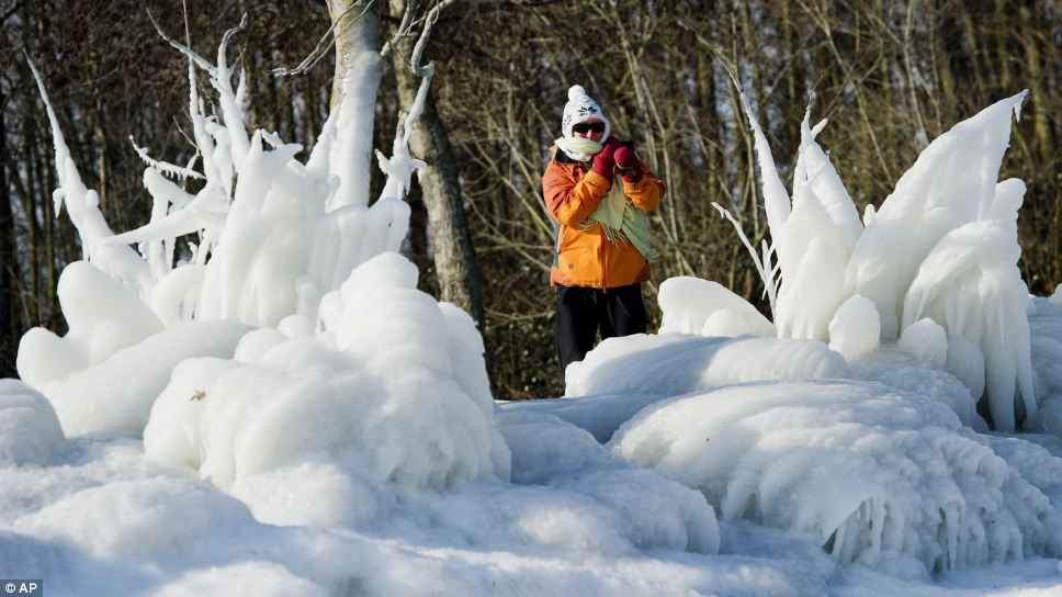 Ice queen: A hiker stands at the  frozen shores of Lake Neuchatel in Yverdon, Switzerland