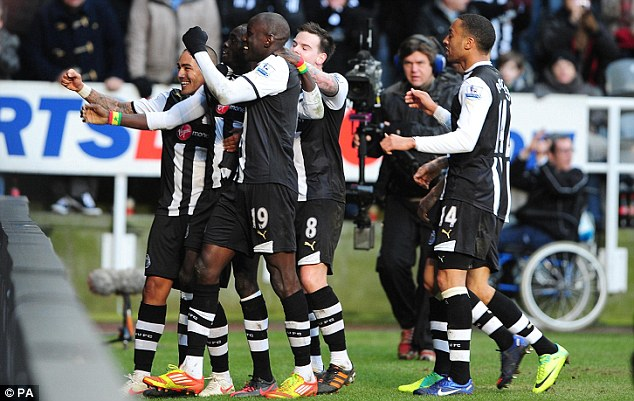 Winner: Cisse (second left) celebrates with his team-mates after grabbing the crucial goal for Newcastle