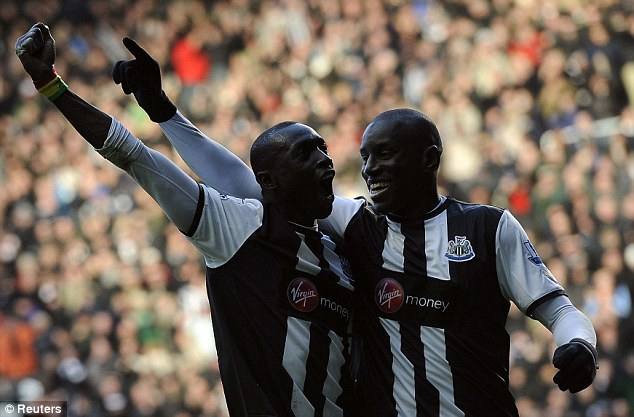 Dream pairing: Ba (right) and Cisse celebrate as the two strikers fire Newcastle to victory
