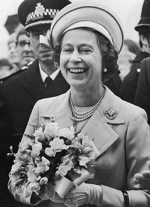 The Queen carries a posy of flowers during the Royal Progress up the Thames to celebrate the Silver Jubilee in 1977