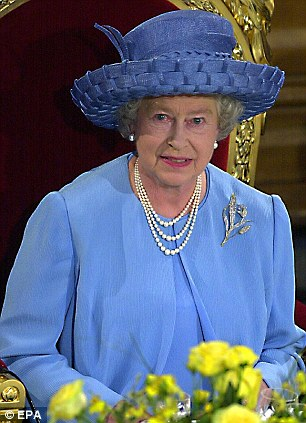 Britain's Queen Elizabeth II smiles while attending a lunch at Guildhall in London to celebrate the Golden Jubilee