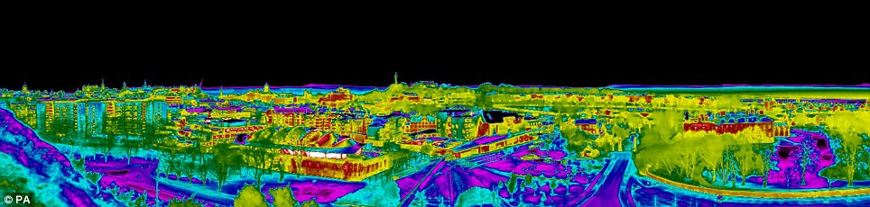 Wasteful: A series of thermal images have been released showing energy wastage in Britain's cities, with Edinburgh, pictured, show a high proportion of yellow, indicating high wastage