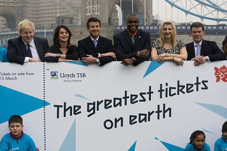 Gaffe: Boris Johnson and Lord Coe pose with Olympians Carl Lewis, Rebecca Adlington to promote tickets for London 2012. It has now emerged they will be printed in the US