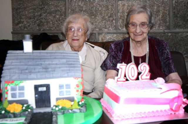 Special bond: The world's oldest living twins, 102-year-old Evelyn Middleton, left, and Edith Ritchie (nee Rennie)