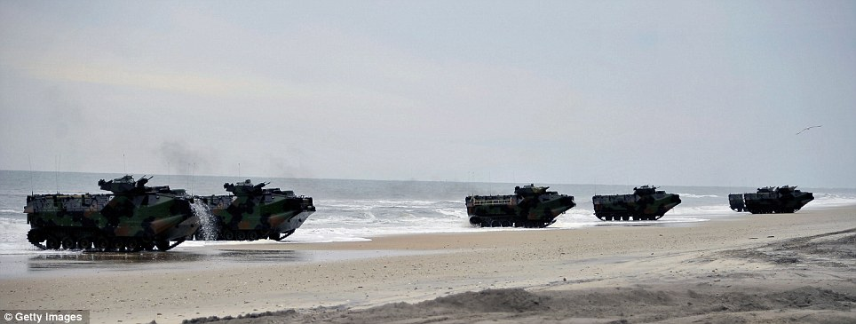Operation: Amphibious assault vehicles storm the shore after driving off the USS Oak Hill during the war games exercise